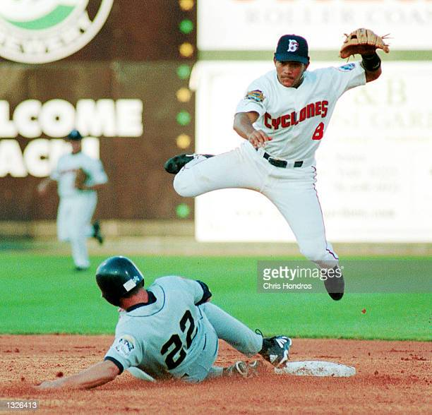 Brooklyn Cyclones second baseman Leandro Arias soars over Mahoning Valley Snapper Curtis Gay during the Cyclones season opener June 25 2001 in...