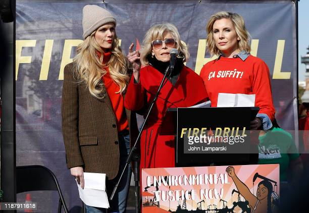 Brooklyn Decker Jane Fonda and June Diane Raphael speak onstage during Fire Drill Friday climate change protest on November 15 2019 in Washington DC...