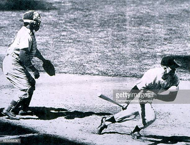 Brooklyn Dodger catcher Roy Campanella watches Mickey Mantle of the New York Yankees head for first base during a game in the World Series in 1955 in...