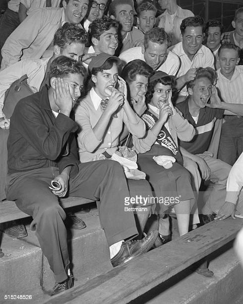 Brooklyn Dodger fans Janet Sevasacia and Alma Villafana enjoy lunch as they are heckled by New York Giants fans at New York's Polo Grounds before the...