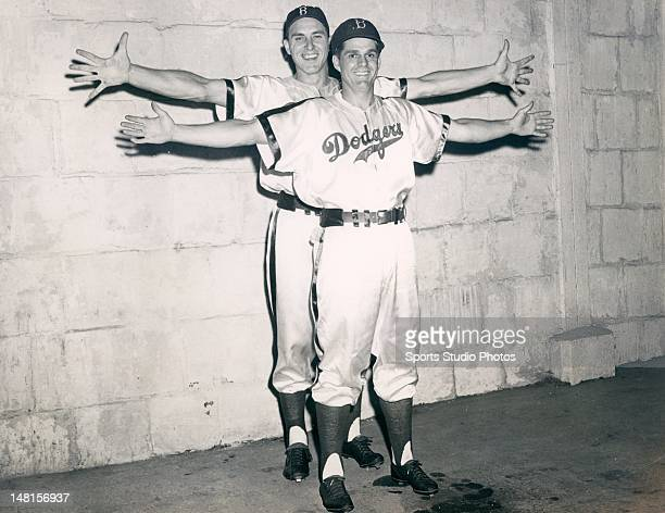Brooklyn Dodger Gil Hodges showing his arm span in front of a unidentified teammate