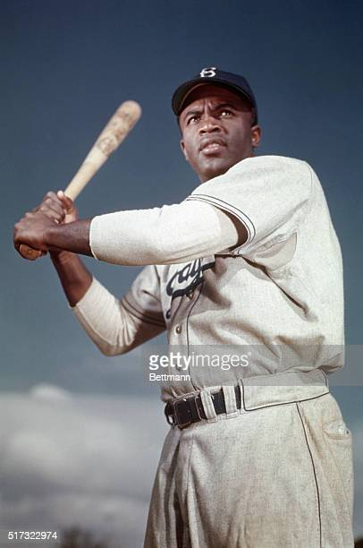 Brooklyn Dodger Jackie Robinson poses in his batting stance. Robinson broke baseball's color barrier when he joined the Dodgers in April 1947, going...