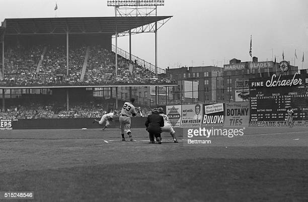 Brooklyn Dodger pitcher Ralph Branca delivers the first ball to New York Giants third baseman Bobby Thomson since the famous fatal pitch that won the...