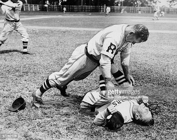 Brooklyn Dodgers' catcher Chink Outen helps manager Casey Stengel loosen up at spring training in Orlando