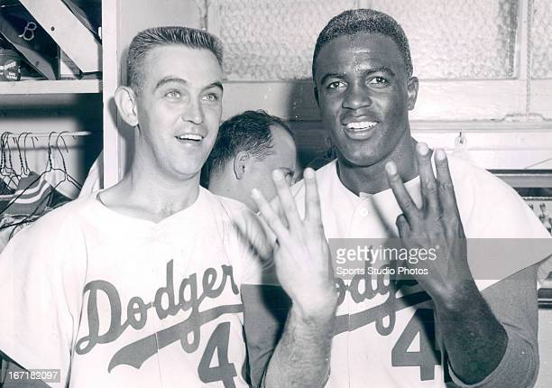 Brooklyn Dodgers Clem Labine and Jackie Robinson celebrate after winning the 6th game of the 1956 World Series