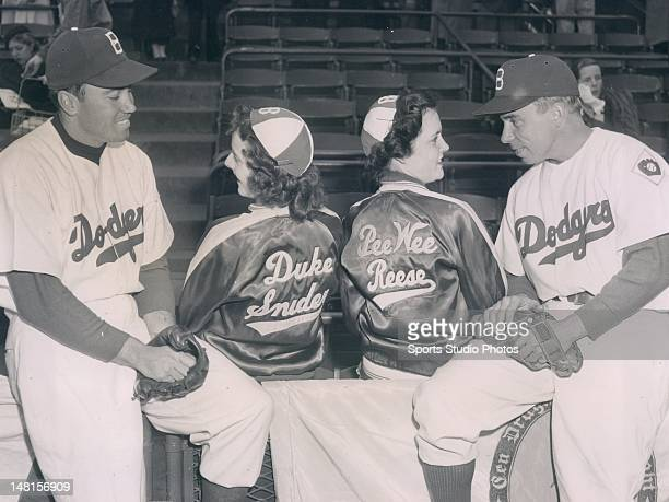 Brooklyn Dodgers Duke Snider and Pee Wee Reese photographed with fans Barbara McWilliams and Peggy Dwyer in 1951