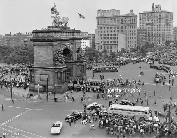 Brooklyn Dodgers fans line the roads around the Soldiers' and Sailors' Arch at Grand Army Plaza, on 'Dodger Day', a victory parade and celebration of...