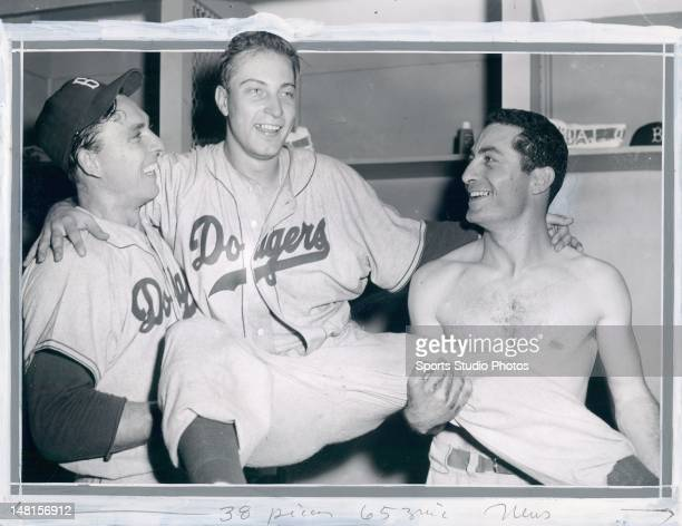 Brooklyn Dodgers Gil Hodges Johnny Podres and Carl Furillo photographed after winning the 7th game of the World Series
