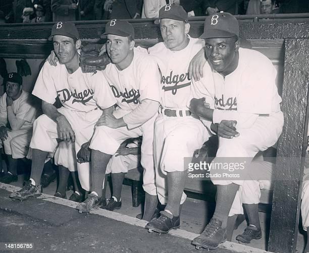 Brooklyn Dodgers infielders Spider Jorgensen, Pee Wee Reese, Eddie Starkey and Jackie Robinson.
