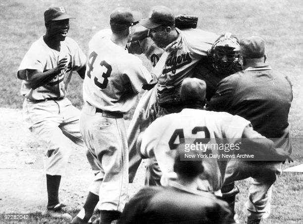 Brooklyn Dodgers' Johnny Podres is swarmed in seconds after the final out of the Dodgers 20 victory over the New York Yankees in final World Series...