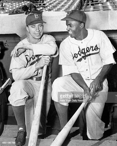 Brooklyn Dodgers' Pee Wee Reese and Jackie Robinson chatting in dugout at Yankee Stadium