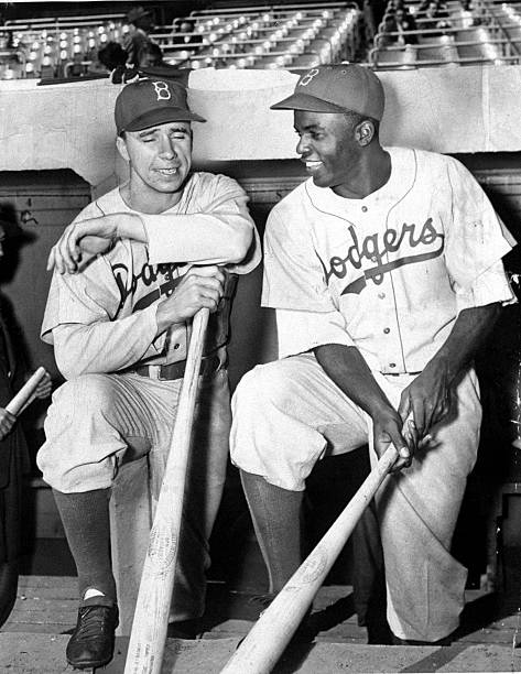 Brooklyn Dodgers' Pee Wee Reese and Jackie Robinson chatting
