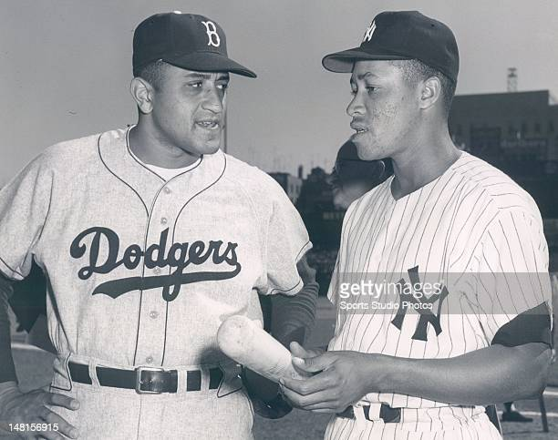 Brooklyn Dodgers pitcher Don Newcombe and New York Yankees catcher Elston Howard photographed at Ebbets Field in Brooklyn NY during The World Series...