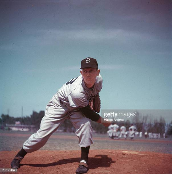 Brooklyn Dodgers' pitcher Russ Meyer leans forward while delivering a pitch from the mound, 1950s.