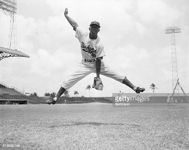 Brooklyn Dodgers rookie second baseman Jim Gilliam leaps in the air before a game in spring training