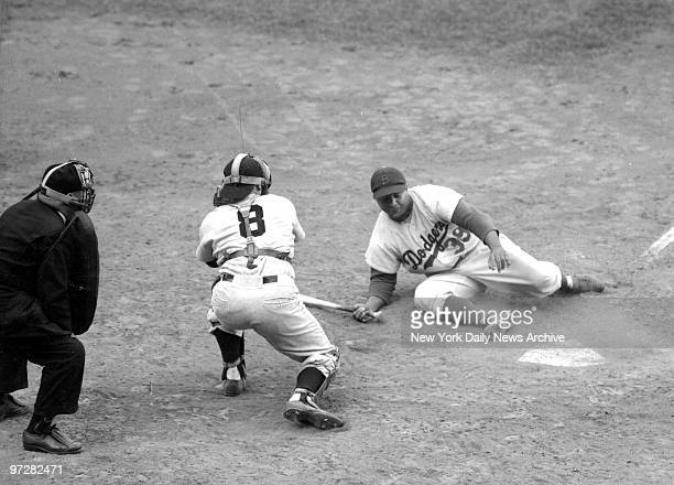 Brooklyn Dodgers' Roy Campanella hits the ground after a close pitch in the seventh inning of the fifth game of the World Series against the New York...