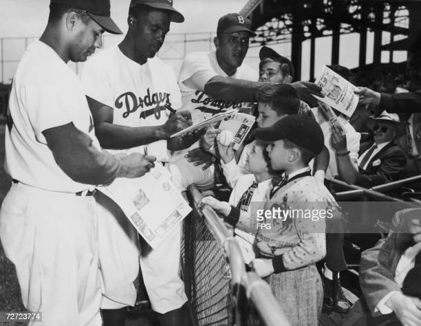 Brooklyn Dodgers signing autographs 2nd June 1949 From left to right Roy Campenella Jackie Robinson and Don Newcombe