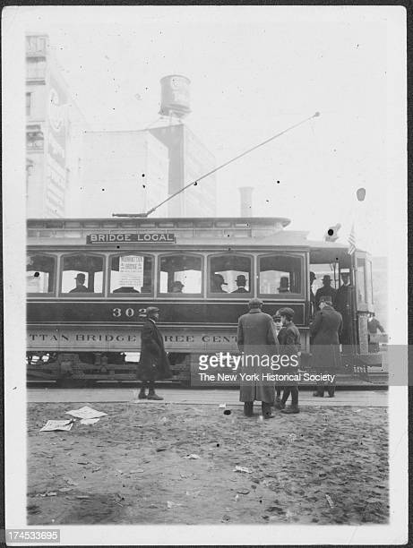 First car of the 3c ? line being opeerated over the Manhattan Bridge, viewed on the Flatbush Avenue Extension, New York, New York, late 1900s.