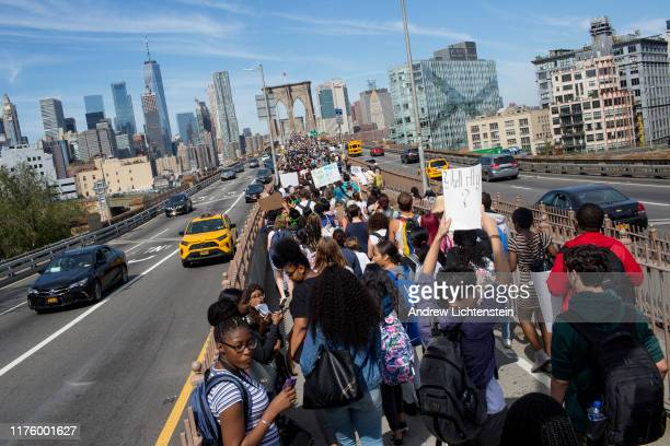 Brooklyn high schools students walk out of school and hold a brief rally on the steps of Borough Hall before marching across the Brooklyn Bridge to...