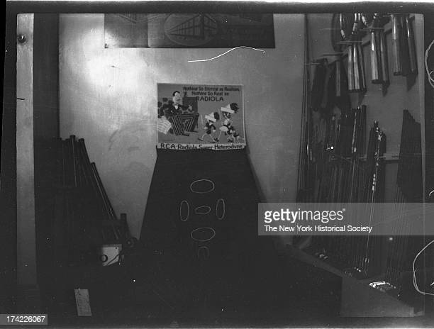 interior of Lenox Sport Shop 767 Flatbush Avenue Close angle on Radiola advertisement tennis rackets and golf clubs on display New York New York late...
