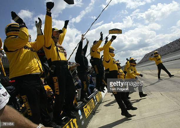 Brooklyn June 16 Matt Kenseth driver of the DeWalt Ford Taurus crew celebrates as their driver croses the finish line first during the Sirius...