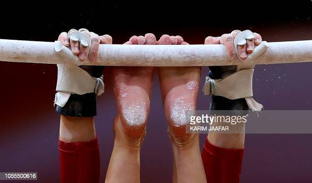 TOPSHOT Brooklyn Moors of Canada competes in the uneven bars during women's team final of the 2018 FIG Artistic Gymnastics Championships at Aspire...