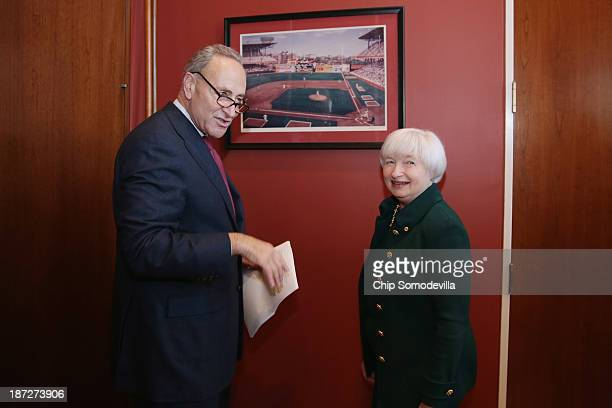 Brooklyn natives Federal Reserve Board of Governors Vice Chair Janet Yellen and US Sen Charles Schumer look at a photograph of Ebbets Field haning in...