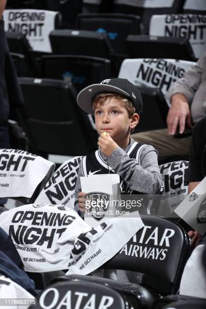 Brooklyn Nets fan eats popcorn before a game against the Minnesota Timberwolves on October 23, 2019 at Barclays Center in Brooklyn, New York. NOTE TO...