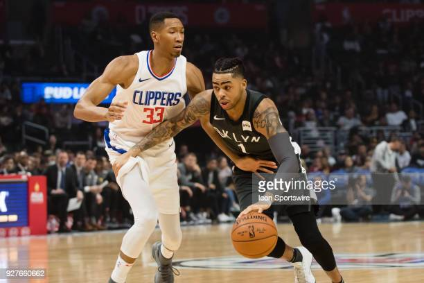 Brooklyn Nets Guard D'Angelo Russell drives the ball up the middle against Los Angeles Clippers Forward Wesley Johnson during the game between the...