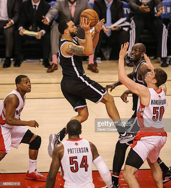 Brooklyn Nets guard Deron Williams elevates to shoot over Toronto Raptors forward Tyler Hansbrough during the game. The Brooklyn Nets defeated the...