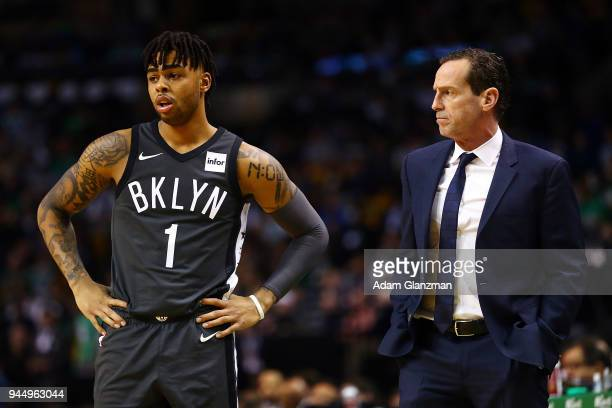 Brooklyn Nets head coach Kenny Atkinson talks to D'Angelo Russell of the Brooklyn Nets during a game against the Boston Celtics at TD Garden on April...