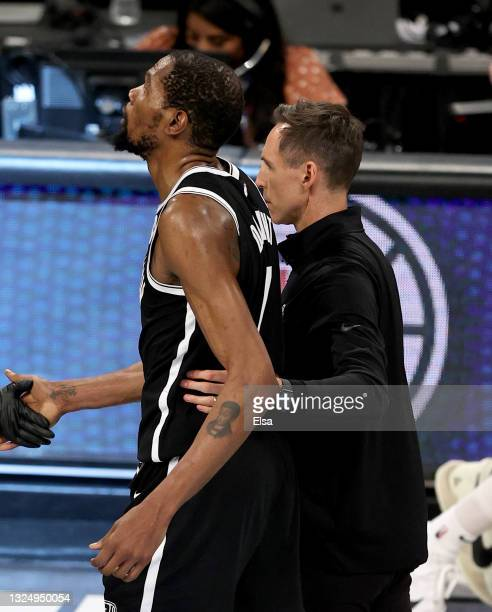 Brooklyn Nets head coach Steve Nash consoles Kevin Durant after game seven of the Eastern Conference second round at Barclays Center on June 19, 2021...