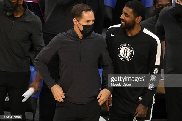 Brooklyn Nets head coach Steve Nash looks on with Kyrie Irving of the Brooklyn Nets during the preseason game against the Boston Celtics at TD Garden...