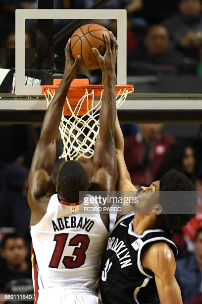 Brooklyn Nets' Jarrett Allen tries to stop Miami Heat's Bam Adebayo from dunking the ball during an NBA Global Games match at the Mexico City Arena...