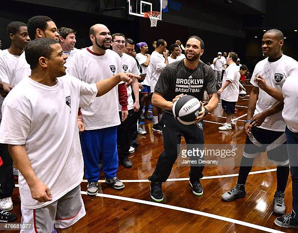 Brooklyn Nets player Deron Williams attends basketball clinic for 65 Special Olympics New York athletes at Barclays practice court at Barclays Center...