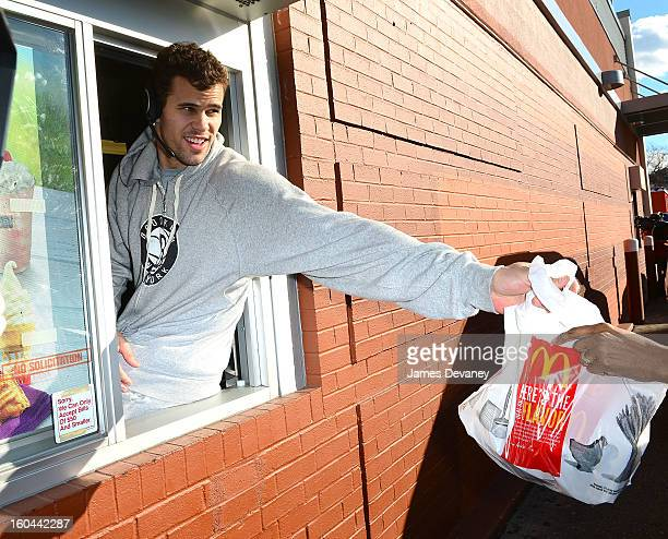 Brooklyn Nets player Kris Humphries participates in the 'Random Acts of Kindness' program by serving McDonald's customers in the Prospect Lefferts...