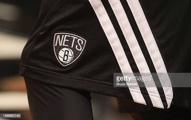 Brooklyn Nets players wear outfits that bear the team logo prior to the game against the Los Angeles Clippers at the Barclays Center on November 23...