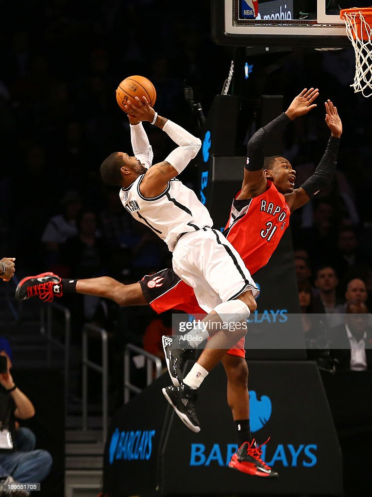 Brooklyn Nets point guard C.J. Watson #1 shoots over Toronto Raptors shooting guard Terrence Ross #31 during their game at the Barclays Center on January15, 2013 in the Brooklyn borough of New York City.