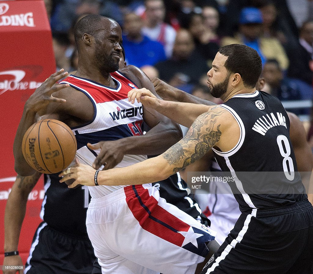 Brooklyn Nets point guard Deron Williams (8) knocks the ball away from Washington Wizards center Emeka Okafor (50) during the first half of their game played at the Verizon Center in Washington, D.C., Friday, February 8, 2013.