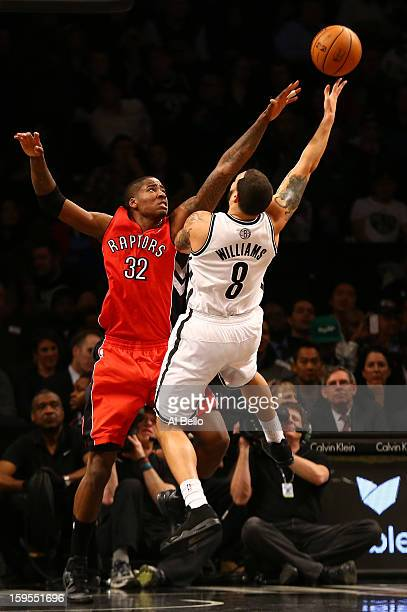 Brooklyn Nets point guard Deron Williams shoots over Toronto Raptors power forward Ed Davis during their game at the Barclays Center on January15...