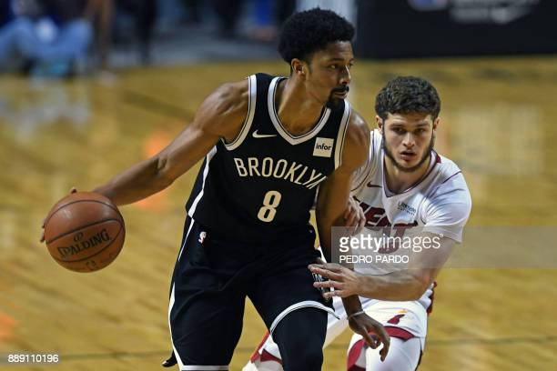 Brooklyn Nets' Spencer Dinwiddie drives the ball marked by Miami Heat's Tyler Johnson during an NBA Global Games match at the Mexico City Arena on...