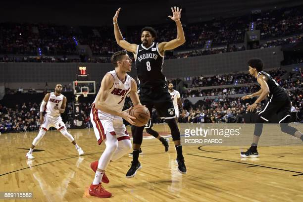 Brooklyn Nets' Spencer Dinwiddie jumps to stop Miami Heat's Goran Dragic during their NBA Global Games match at the Mexico City Arena on December 9...