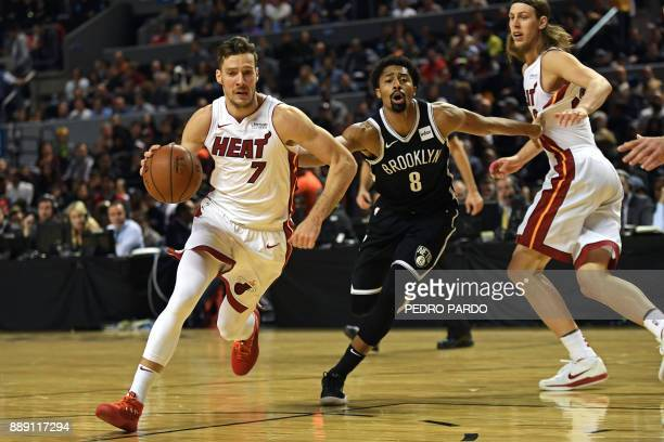 Brooklyn Nets's Spencer Dinwiddie vies for the ball with Miami Heat's Goran Dragic during their NBA Global Games match at the Mexico City Arena on...