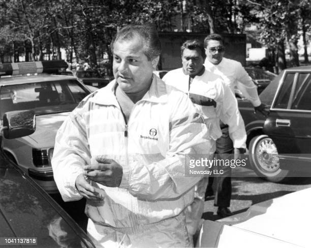 Reputed Gambino crime captain Gene Gotti foreground is followed by close friend and reputed mob soldier John Carneglia as the two surrendered to...