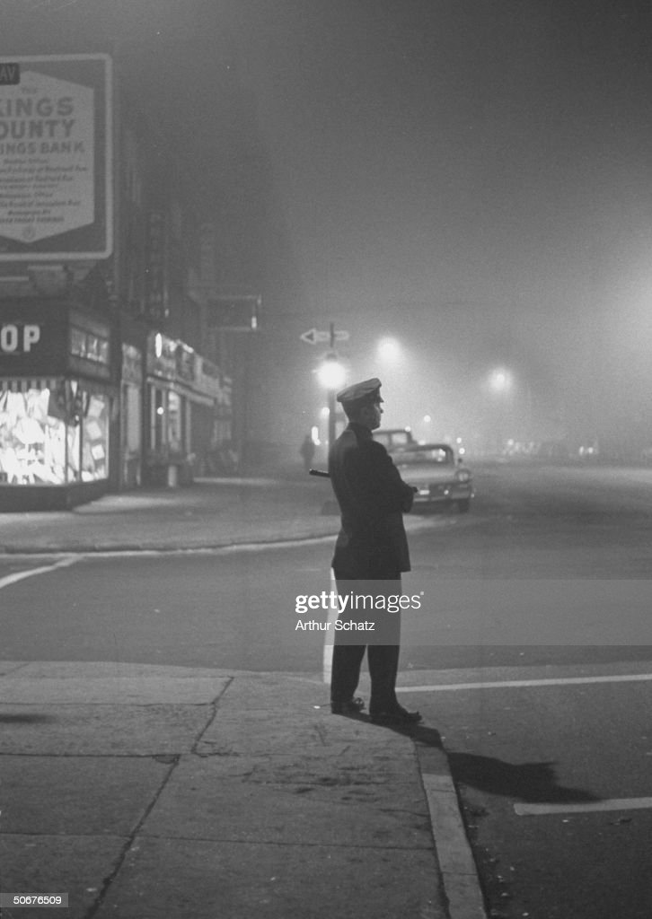 Brooklyn police patrolling foggy streets, during investigation of rape case.