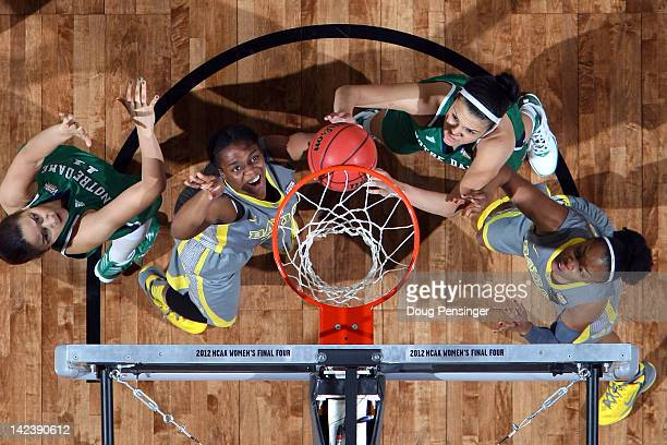 Brooklyn Pope and Odyssey Sims of the Baylor Bears get in rebound position against Natalie Achonwa and Kayla McBride of the Notre Dame Fighting Irish...