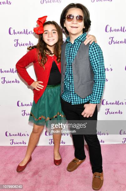 Brooklyn Robinson and Bryson Robinson attend Chandler Kinney's 3rd Annual Holiday Toy Drive Event on December 09 2018 in Los Angeles California