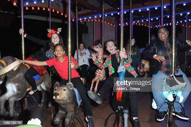 Brooklyn Robinson Brandin Stennis Bryson Robinson and Akinyele Caldwell attend the LA Zoo Lights Special Preview/VIP Night held at Los Angeles Zoo on...
