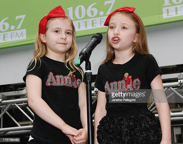 Brooklyn Shuck and Emily Rosenfeld from the cast of Annie perform at 1067 LITE FM's Broadway in Bryant Park 2013 at Bryant Park on August 8 2013 in...
