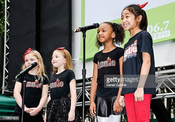 Brooklyn Shuck, Emily Rosenfeld Tyrah Skye Odoms and Amaya Braganza from the cast of 'Annie' perform during 106.7 LITE FM's Broadway in Bryant Park...